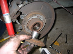 The hub miraculously came out without the outboard inner bearing race.  Usually the race stay on the hub.