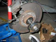 Install a new snap ring.  I'm sure you can reuse the old one but a new one is under $4.00 at the parts counter.  If the snap ring will not fit into the groove, the bearing is not fully seated.  break out the bearing tool again and push it all the way in.