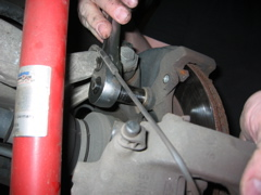 Remove the two carrier bolts with a 16mm socket.