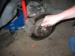 Now you can remove the brakes.  pry off the anti rattle clip.